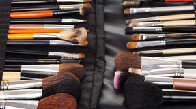 Set  professional makeup brushes in black leather case. Stock Photos