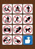 Set of prohibitive icons of not camping, no bonfire, littering, hunting,  stepping, fishing, silence. Icons in blue color. On wooden background. Vector image Royalty Free Stock Image