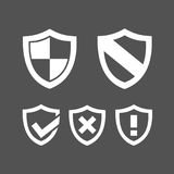 Set of protection shield icons. On a dark background stock illustration
