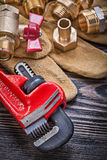 Set of protective gloves brass plumbing tools on wooden board Royalty Free Stock Photography