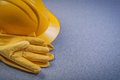Set of protective gloves building helmet on grey background cons Royalty Free Stock Images