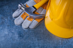 Set of protective gloves yellow hard hat and metal Royalty Free Stock Photo