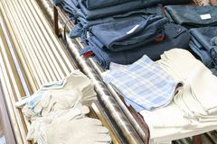 A set of protective work clothes for workers, clothes, working robes, gloves are on the table royalty free stock photos