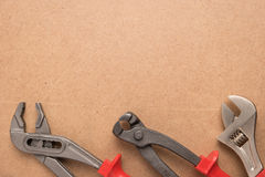 Set of pump plier, plier and wrenches. Tools over a wood panel. Royalty Free Stock Photography