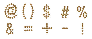 A set of punctuation marks composed of pet food (cat or dog) lab. Punctuation marks of dry cat and dog food,  on white background Royalty Free Stock Image