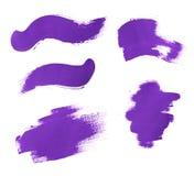 Set of purple brush strokes of acrilic paint as sample of art product Stock Image