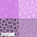 Set of purple floral patterns Stock Images