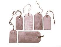 Set of purple hang tags. Set of purple grungy hang tags Royalty Free Stock Photos