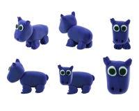 Set of purple hippopotamus made from plasticine. Set of cute purple hippopotamus made from plasticine stock image