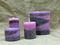 Set of purple wax candles Stock Photography