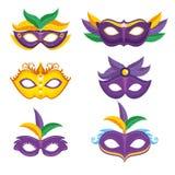 Set of purple and yellow carnival mask mardi gras stock photos