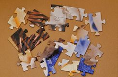 Set of puzzles on wooden background stock photo