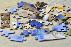 A set of puzzles on wooden floor stock photo