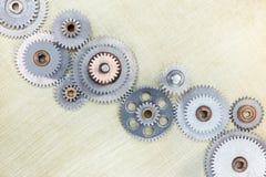 Set różni metali gearwheels na porysowanym mosiężnym tle Obraz Royalty Free