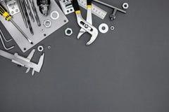 Set różni metali narzędzia, instrumenty na popielatym tle i Fotografia Stock