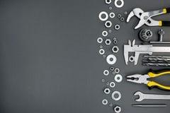 Set różni ręki pracy narzędzia z chrom dokrętkami na szarym backgr zdjęcia royalty free