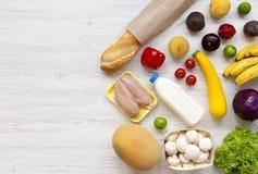 Set różnorodny zdrowy jedzenie na białej drewnianej powierzchni, odgórny widok Kulinarny karmowy tło pojęcia zdrowe jedzenie obrazy stock