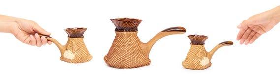 set różny Ceramiczny turek dla kawy z ręką pojedynczy białe tło obrazy stock