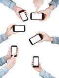 Set ręki jest koszulowego mienia mądrze telefonami Zdjęcie Royalty Free