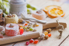 Set of rahat lokum with candied peels, nuts and sugar powder Royalty Free Stock Photos