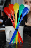 Set of rainbow Colored Spoons on table in cafe. Set of rainbow Colored tea Spoons on table Stock Image