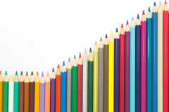 Set of rainbow colours wooden pencil background. Rainbow colours of wooden pencils on white background Royalty Free Stock Photos