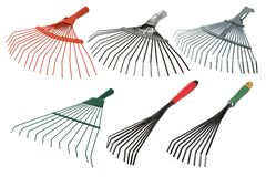 Set of rakes isolated on white background. Garden instrument stock images