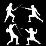 A set of raster silhouettes of people that are engaged in sports fencing. Silhouettes of fencers in different poses on a black background Royalty Free Stock Photo