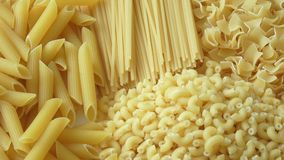Set of raw dry pasta. Variety of types of Italian pasta. stock video footage