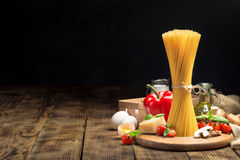 Set raw food for cooking Italian food on wooden table Stock Photos