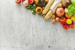 Set raw food wooden background border, top view. Healthy food. Set of raw food on white wooden background with border, top view. Healthy food concept Royalty Free Stock Photography