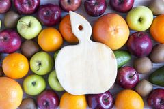 Set of raw fruits with board on white wooden background. Healthy food concept, top view. Flat lay. Summer background Royalty Free Stock Photography