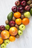 Set of raw fruits with copy space on white wooden background. Flat lay. Summer background. Set of raw fruits with copy space on white wooden background. Healthy Stock Photo