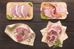 Set raw meat on cutting board on the wooden background Royalty Free Stock Images