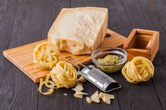 Set of raw pasta and addons on wooden table. Studio picture stock images