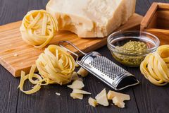 Set of raw pasta and addons on wooden table. Studio picture royalty free stock photos