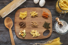 A set of raw pasta on a wooden desk Stock Image