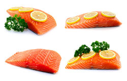 Set of raw salmon fillet. Set of four raw salmon fillet with parsley and lemon Stock Photo