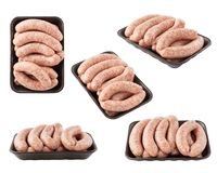 Set of raw sausages on black foam tray shot from different angle. S. Isolated royalty free stock photos