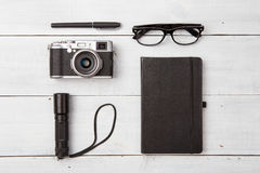 Set of reading glasses  and cool stuff on wooden table Royalty Free Stock Images