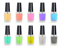 Set of a real 3d colorful nail polisher glass bottle Royalty Free Stock Images