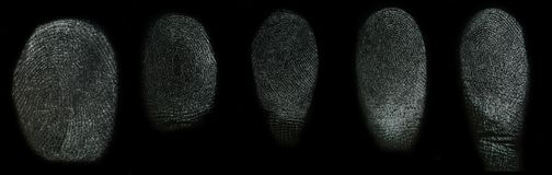 Set of real finger prints. Isolated on black background stock photos
