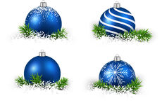 Set of realistic blue christmas balls. Colorful set of blue realistic christmas balls on snow with fir branches. Vector illustration Stock Photos