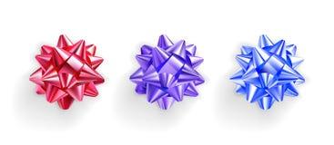 Set realistic bows of shiny ribbons. Royalty Free Stock Image