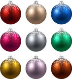 Set of realistic christmas balls. Colorful christmas balls with snow. Set of isolated realistic decorations. Vector illustration Stock Photos