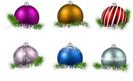 Set of realistic color christmas balls. Colorful set of realistic christmas balls on snow with fir branches. Vector illustration Stock Images