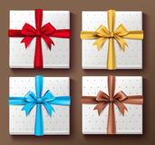 Set of Realistic 3D Colorful Gift Boxes with Patterns. And Silk Ribbon and Bow Elements and Decoration for Valentines Day and Birthday Celebrations. Isolated Royalty Free Stock Image