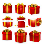 Set of realistic 3d gift boxes. Collection of 3d gift red boxes with satin golden bows. Realistic vector illustration Stock Image