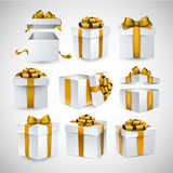 Set of realistic 3d gift boxes. Collection of 3d gift boxes with satin golden bows. Realistic vector illustration Stock Images