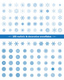 Set of realistic and decorative snowflakes, blue on white background Stock Photo